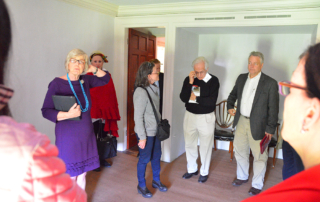 Group in Martha Jefferson's children's room, Monticello, including Clay Jankinson