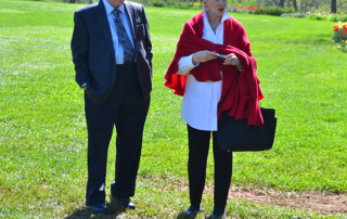 Irwin Marcus and Angela Hill on lawn, Monticello