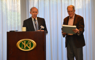 Jerry Blackman thanking Dan Kowler for years of service as President and Treasurer